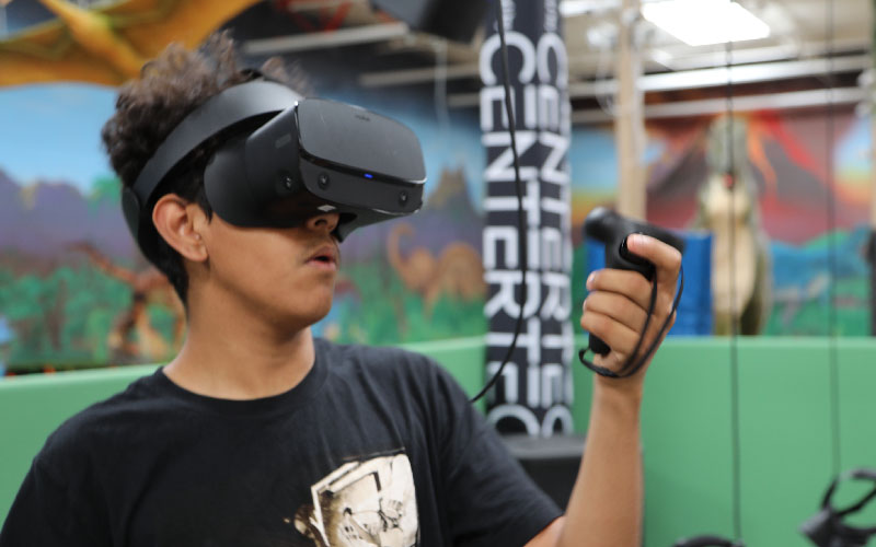 a boy playing with a virtual reality console